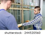 two  workmen working with glass ... | Shutterstock . vector #244520560