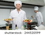 positive chef with assistant... | Shutterstock . vector #244520599
