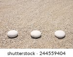 three stones on the sand | Shutterstock . vector #244559404