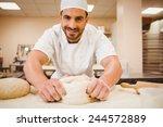baker kneading dough at a... | Shutterstock . vector #244572889