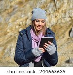 woman using a tablet in a cold... | Shutterstock . vector #244663639