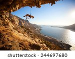 female rock climber hanging on... | Shutterstock . vector #244697680