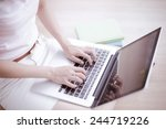 asian woman using laptop at home | Shutterstock . vector #244719226