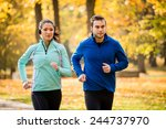couple jogging together in... | Shutterstock . vector #244737970