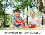 cute kids in park eating juicy... | Shutterstock . vector #244804360