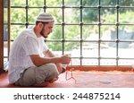 bearded man praying in the... | Shutterstock . vector #244875214