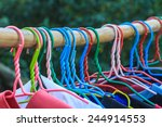 Stock photo shirts hanging on clothes line in morning 244914553