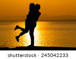 Silhouette of couple in love,Love and sensuality and valentine day concept at lake side