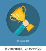 hand holding winner's trophy...   Shutterstock .eps vector #245044420