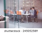 Stock photo young business people group have meeting and working in modern bright office indoor 245052589