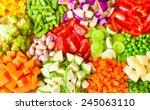 Various Cut Vegetables On Wood