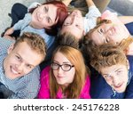 group of young people sitting... | Shutterstock . vector #245176228