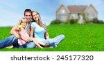happy family near new home.... | Shutterstock . vector #245177320