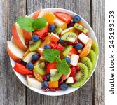 Fruit And Berry Salad On Wooden ...