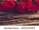 Roses On Old Wooden Board ...