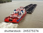 Top View Of Tugboat Pushing A...