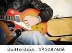 Close Up Of A Guitar Player...