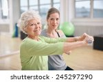 senior woman exercising with... | Shutterstock . vector #245297290