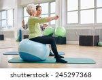 female trainer assisting senior ... | Shutterstock . vector #245297368