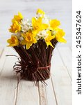 Daffodils In A Twig Vase On Th...