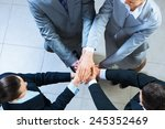 team of four businessmen with... | Shutterstock . vector #245352469