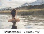 Girl in a hot spring in Iceland Landmannalaugar