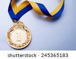 gold medal in the foreground on ... | Shutterstock . vector #245365183
