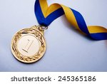 gold medal in the foreground on ... | Shutterstock . vector #245365186
