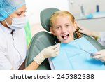 cute smiling girl in at dentist ... | Shutterstock . vector #245382388