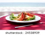 Salad At Red Tablecloth With...
