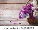 Basket With A Branch Of Lilac...
