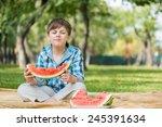 cute boy eating juicy... | Shutterstock . vector #245391634