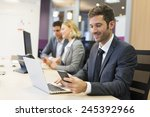 Businessman On Mobile Phone In...