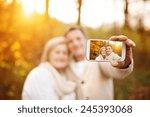active seniors taking selfies... | Shutterstock . vector #245393068