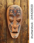 wooden carved ritual statue face | Shutterstock . vector #245420020
