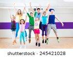 dance teacher giving children... | Shutterstock . vector #245421028