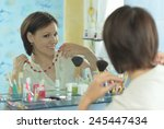 beautiful woman comb her hair... | Shutterstock . vector #245447434