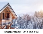 Snow Covered Chalet In The...