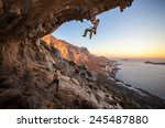 male rock climber climbing on a ... | Shutterstock . vector #245487880