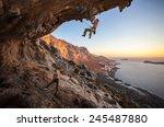 male rock climber climbing on a ... | Shutterstock . vector #245487880