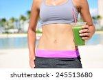 Fitness Woman Drinking Green...