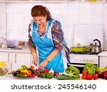 Mature Woman Preparing Food At...