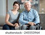 young pretty female caretaker... | Shutterstock . vector #245553964