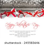 heart shaped gifts on wooden... | Shutterstock . vector #245583646