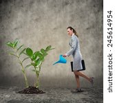 businesswoman with can watering ... | Shutterstock . vector #245614954