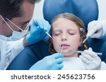 dentist with assistant... | Shutterstock . vector #245623756