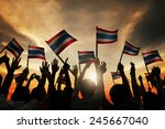 group of people waving flag of... | Shutterstock . vector #245667040