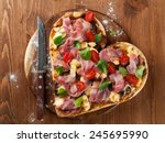 heart shaped pizza with bacon...   Shutterstock . vector #245695990