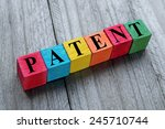 word patent on colorful wooden... | Shutterstock . vector #245710744