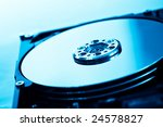 hard disk without head in blue with shallow depth of field - stock photo